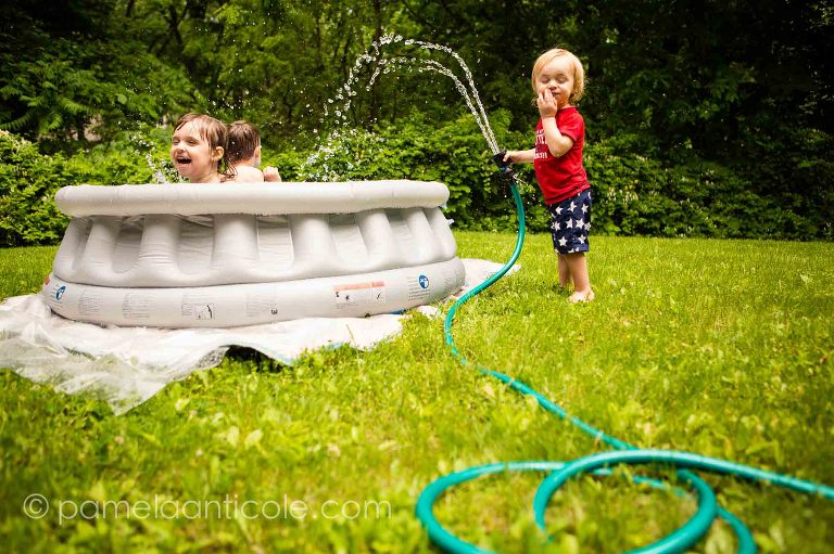 documentary family photographer in pittsburgh, kids swimming in the pool