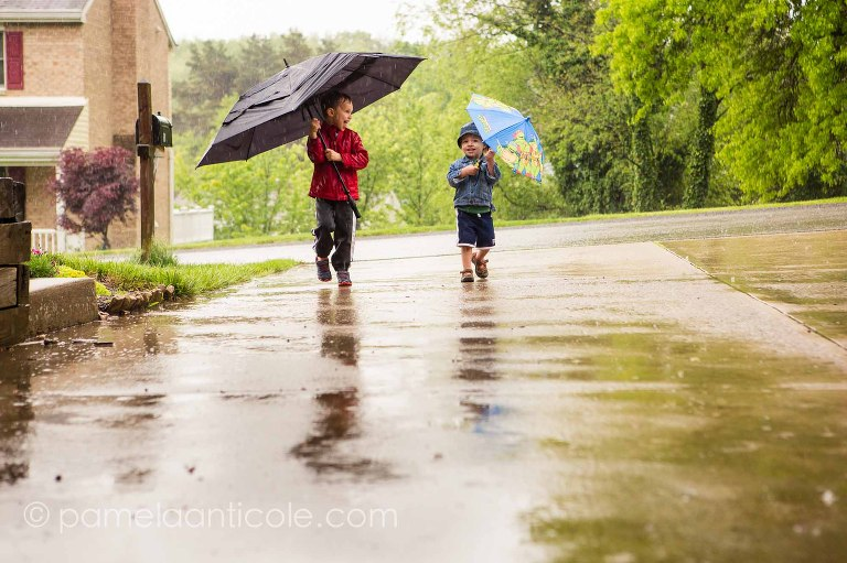 documentary family photo, kids playing in the pittsburgh rain