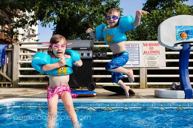 kids jumping into the sandbridge beach house pool