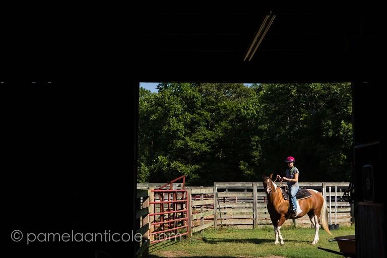 riding a horse through the barn in clemson sc