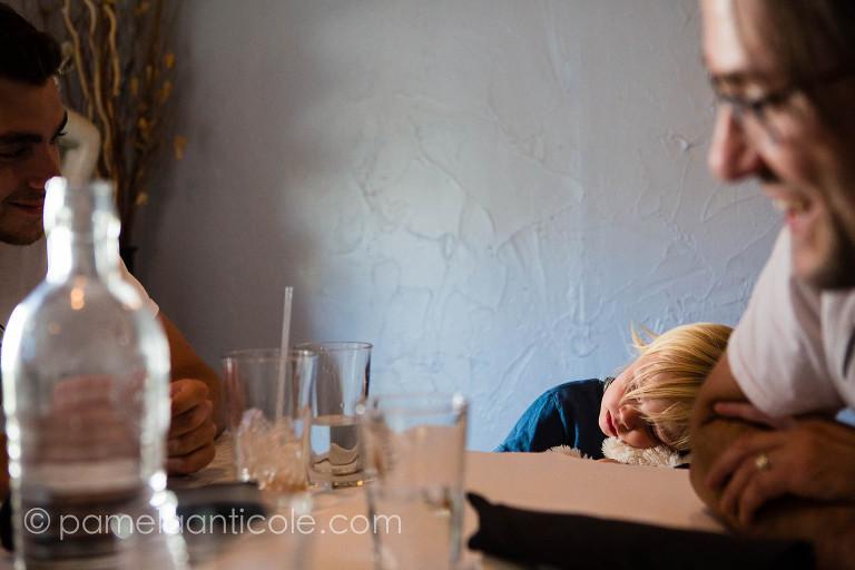 tired toddler at dinner restaurant hershey pa
