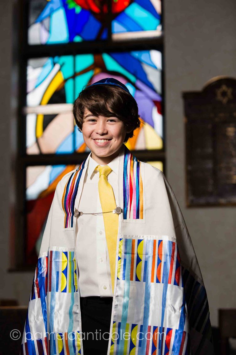 Bar Mitzvah portrait in front of stained glass window at Beth Shalom in Ambridge PA outside of Pittsburgh