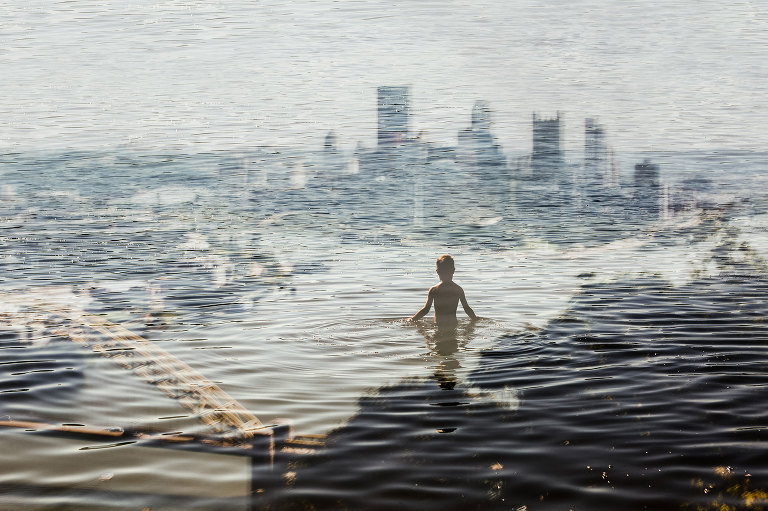 unique fine art photography of pittsburgh, pittsburgh print for sale, boy wading through water over city