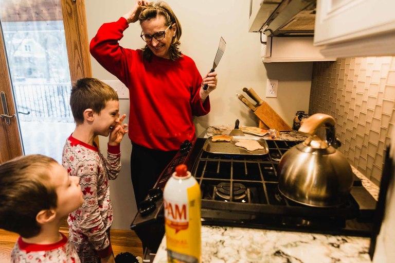 grandma and kids making pancakes, laughing at silly shapes