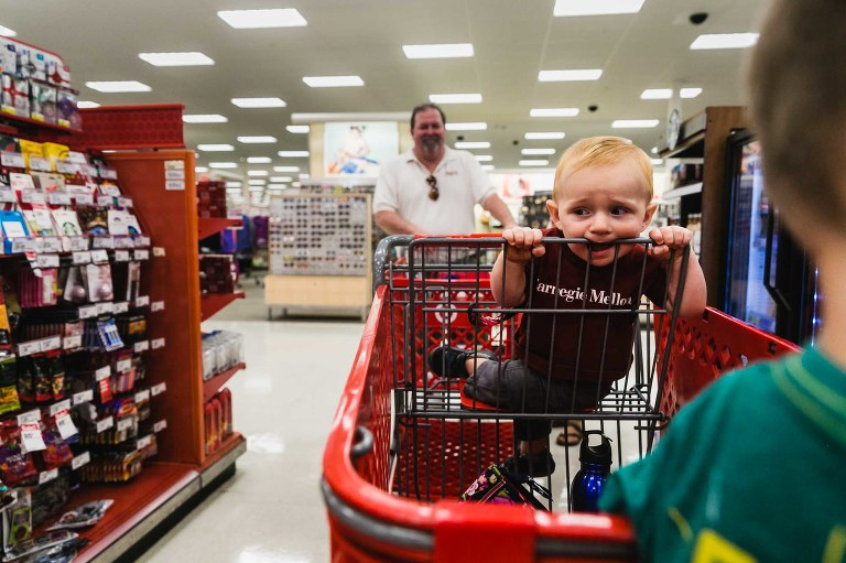 baby in target disgruntled eating cart