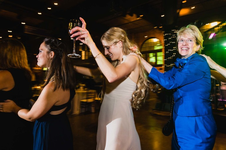 bridesmaids dancing conga line at heinz history center wedding reception in pittsburgh pa
