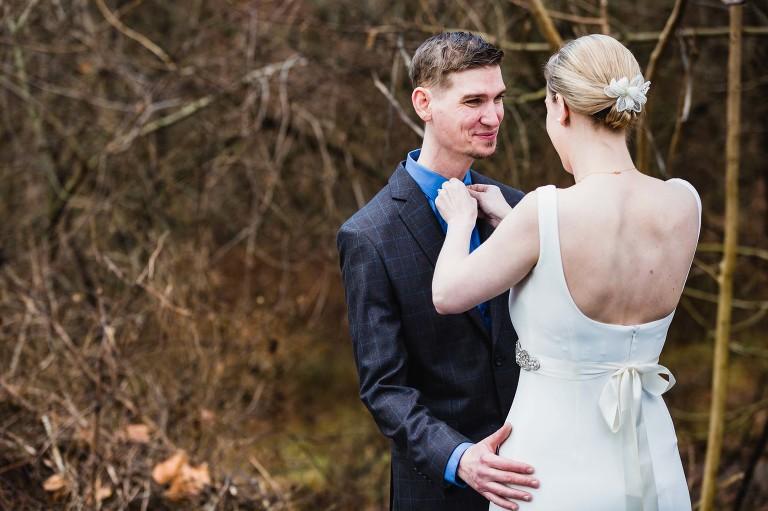 bride fixes groom's tie