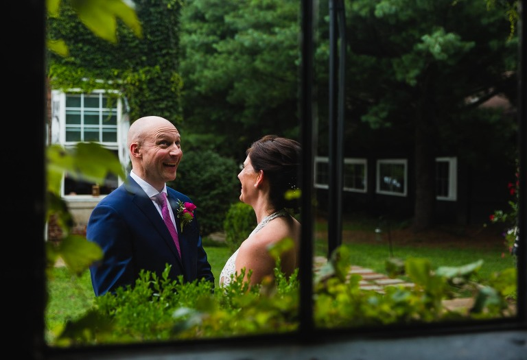 groom seeing bride for the first time, laughing and making goofy faces