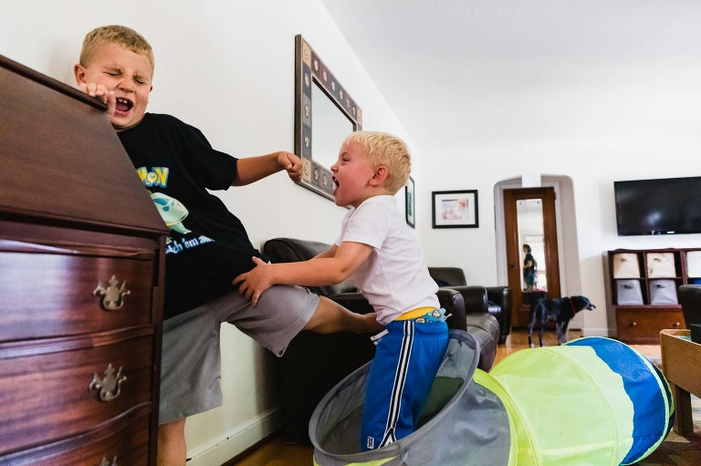 boys fight in their living room