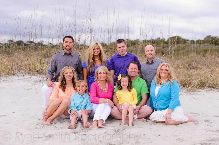 Colorful family portrait by the dunes on the beach