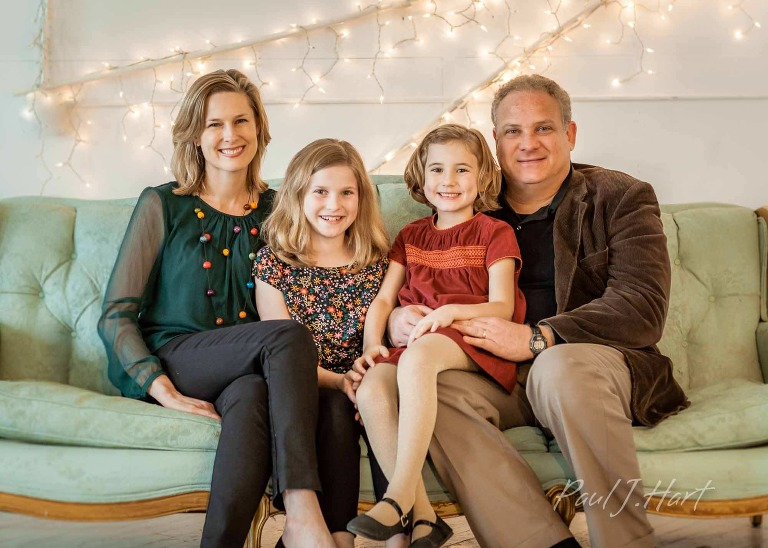 studio portrait of family on sofa