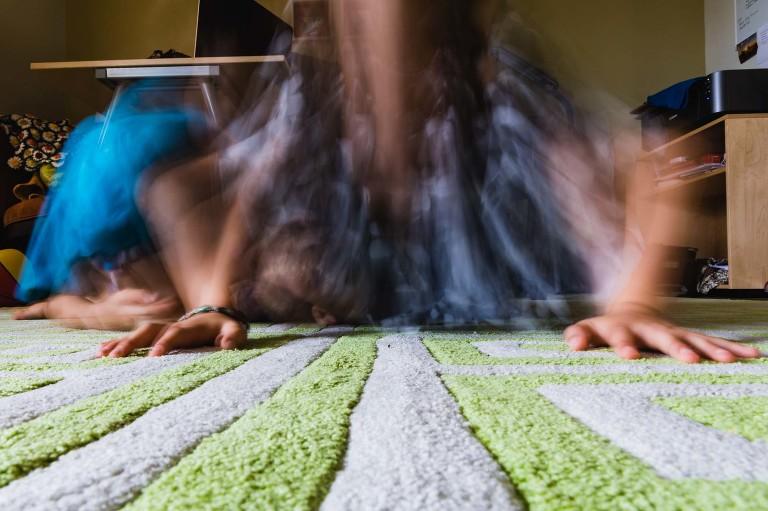 blurry ghost like kids doing pushups