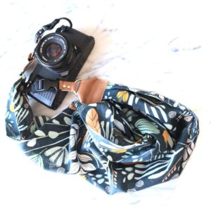 camera scarf strap, with vibrant pattern in neutral blue tones
