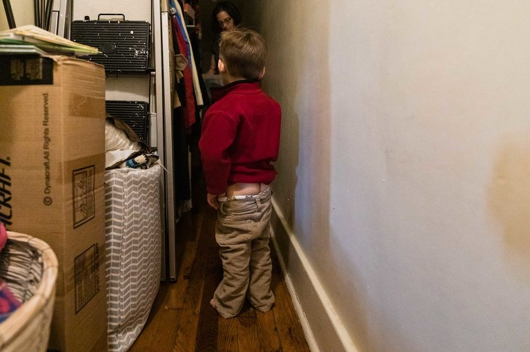 toddler pulls his pants down to display his bum, nonchalantly while talking to his mom