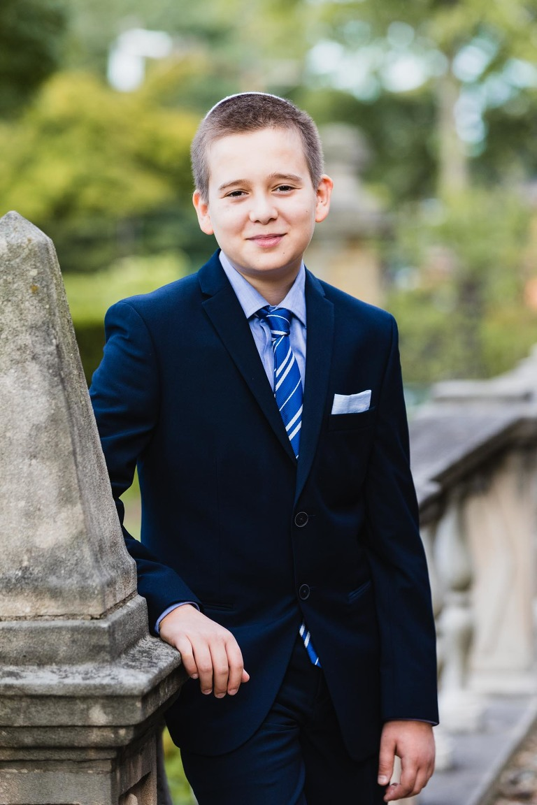 portrait of bar mitzvah phineas hammer in the garden at temple sinai in shadyside, pittsburgh
