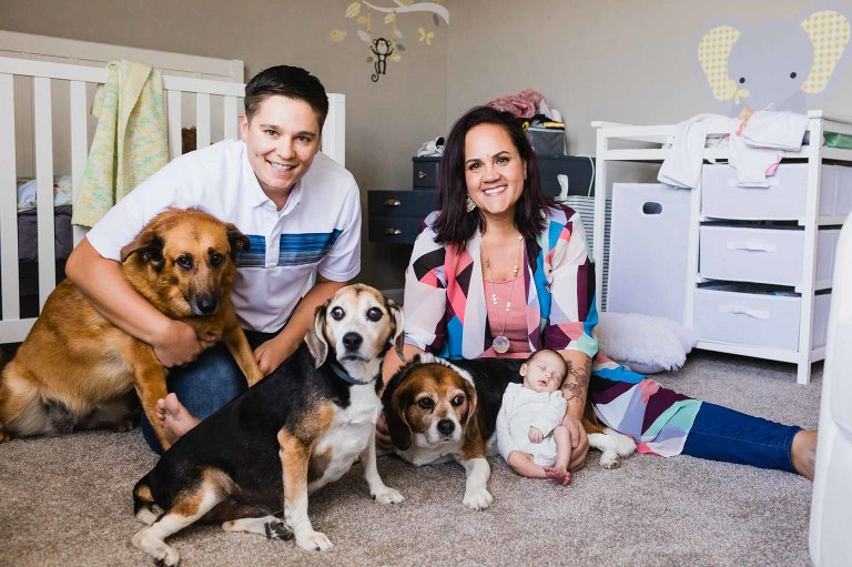 family portrait with newborn baby girls and dogs