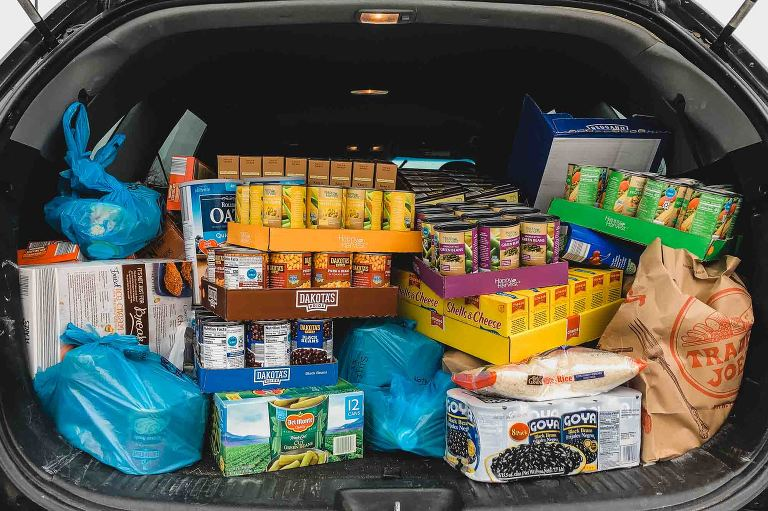 open car trunk full of non perishable food donations for the north hills community outreach center in pittsburgh