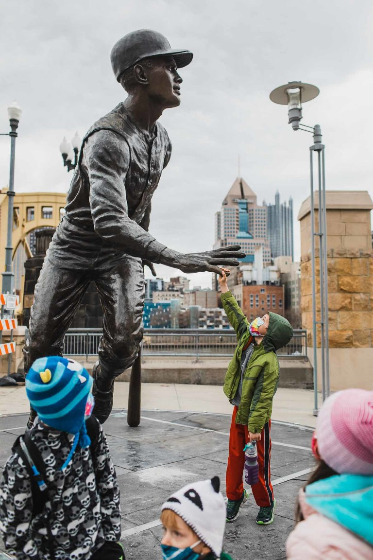 kids play with the roberto clemente statue at pnc park in pittsburgh