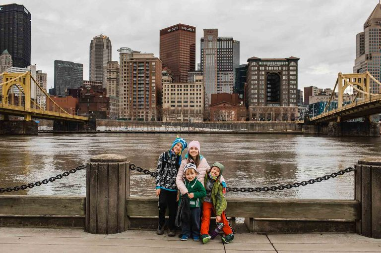 kids in front of downtown pittsburgh, along the riverfront trail on the north shore