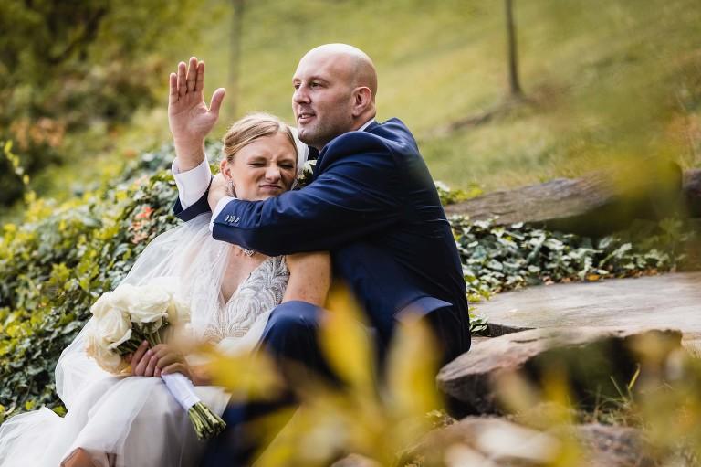 groom puts bride in a headlock