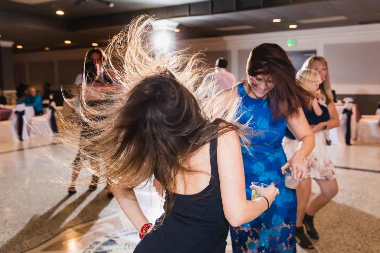 wild dancing at a wedding reception, with girl flipping her hair in the air