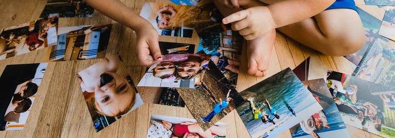 kids looking at family photos