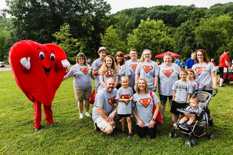 group photo of the annual heart walk in north park, fundraiser for heart defect research