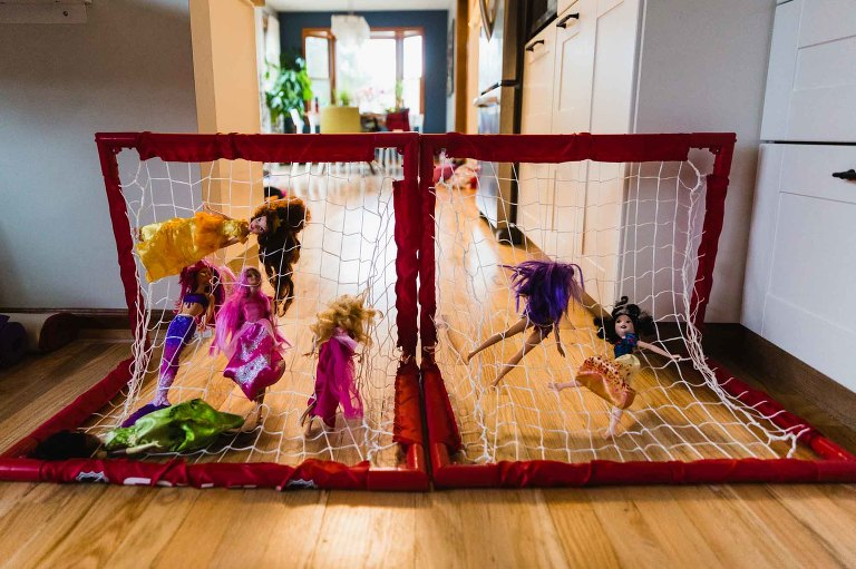 barbies caught up in a soccer net